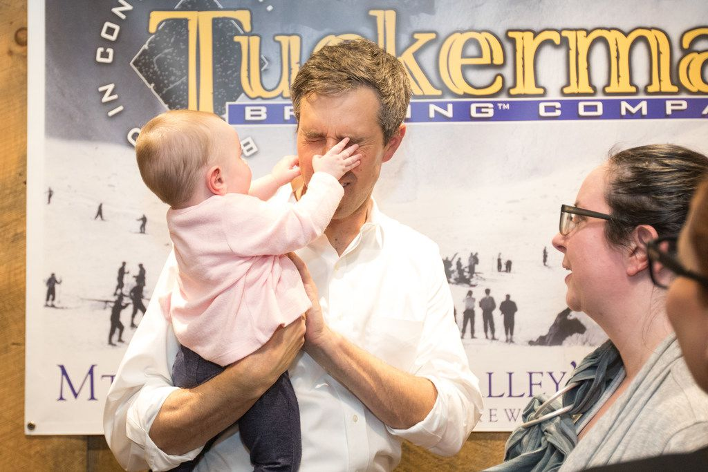 Democratic presidential candidate Beto O'Rourke has his face grabbed by a baby at a meet and greet at Tuckerman Brewing on March 20, 2019 in Conway, New Hampshire.