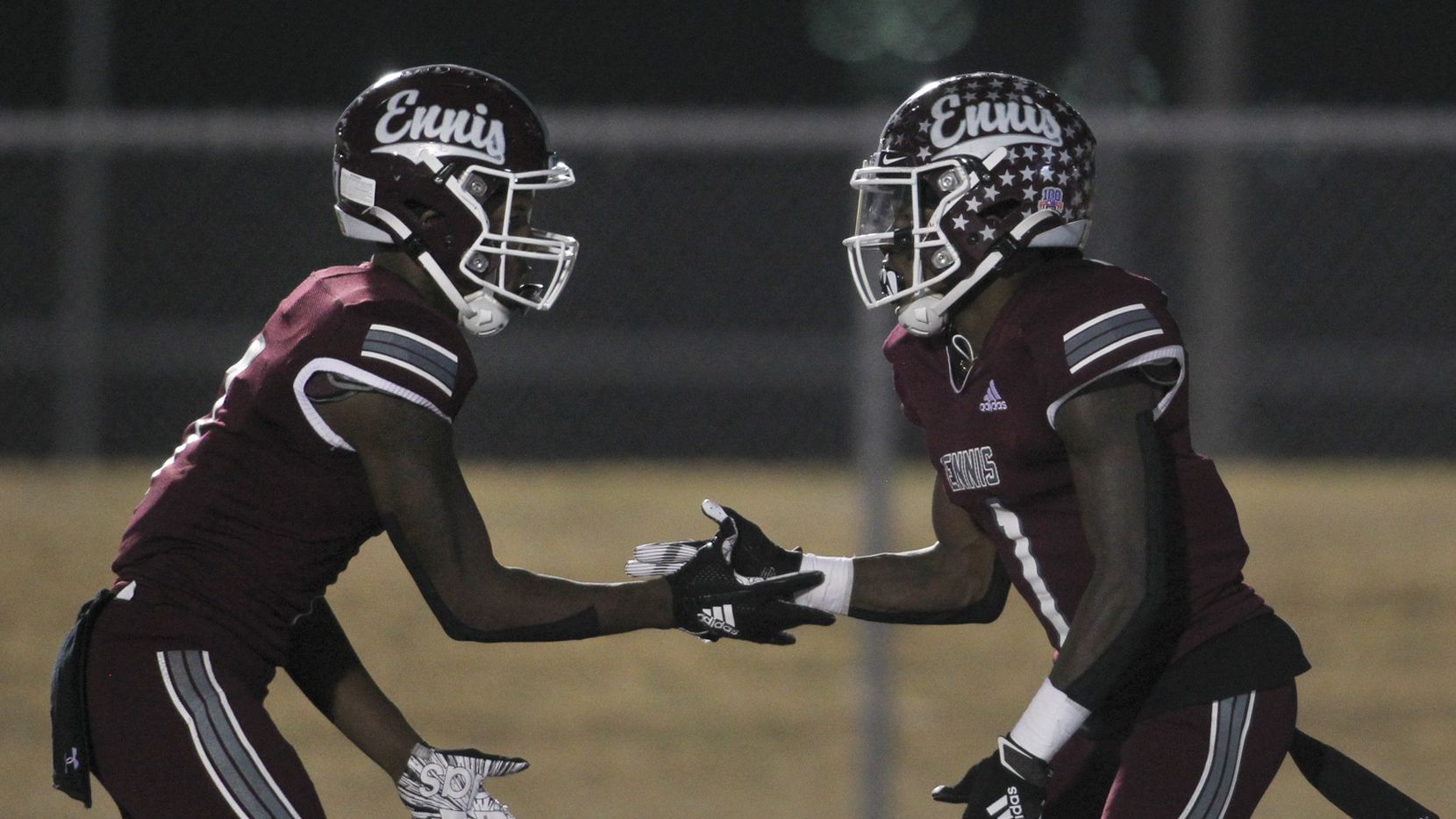 Ennis receiver Karon Smith (1), right, celebrates with receiver Laylon Spencer (7), following Smith's second quarter touchdown reception in their game against Frisco Liberty. The two teams played their Class 5A Division ll  bi-district round playoff football game at Lion Memorial Stadium in Ennis on December 11, 2020.