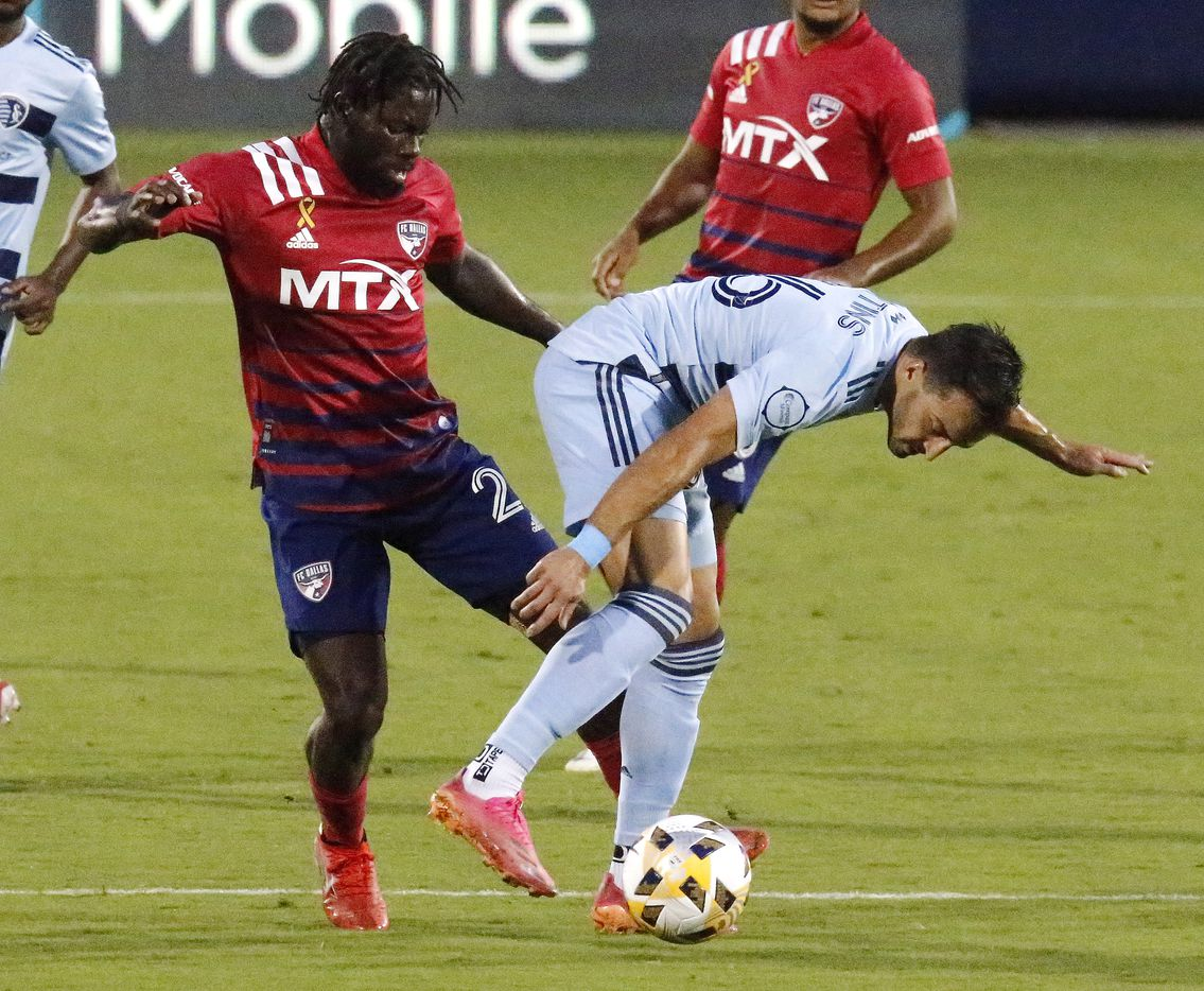 FC Dallas midfielder Ema Twumasi (22) and Sporting Kansas City midfielder Graham Smith (16) compete for position during the first half as FC Dallas hosted Sporting Kansas City at Toyota Stadium in Frisco on Wednesday, September 29, 2021. (Stewart F. House/Special Contributor)