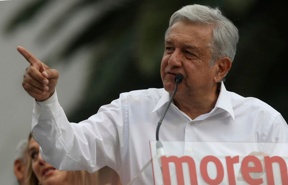 """Mexican presidential hopeful Andres Manuel Lopez Obrador, leader of the National Regeneration Movement, MORENA, speaks during a rally at the Revolution Monument in Mexico City. Mexico's latest political scandal involves Lopez Obrador, when a slickly-produced videotape, complete with edits, ominous theme music and subtitles, was leaked, showing a Lopez Obrador associate receiving wads of cash allegedly given to her by """"businessmen"""" and intended for Lopez Obrador himself. The video, according to some, smacked of old-style Institutional Revolution Party dirty tactics."""