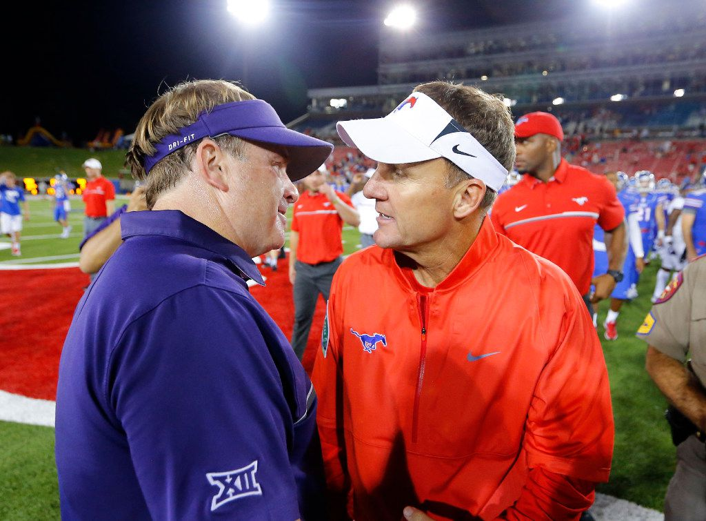 TCU Horned Frogs head coach Gary Patterson (left) and Southern Methodist Mustangs head coach Chad Morris visit at midfield following their game at Gerald J. Ford Stadium in University Park, Texas, Friday, September 23, 2016. TCU won the Battle of the Skillet, 33-3. (Tom Fox/The Dallas Morning News)