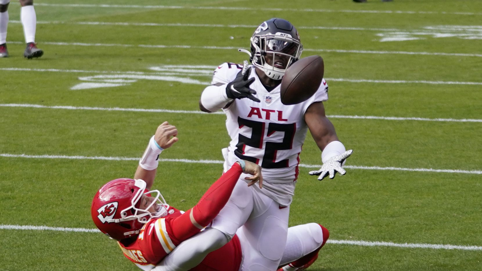 A pass intended for Kansas City Chiefs quarterback Patrick Mahomes is intercepted by Atlanta Falcons safety Keanu Neal during the first half an NFL football game, Sunday, Dec. 27, 2020, in Kansas City.