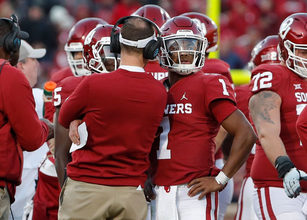 Oklahoma head coach Lincoln Riley, left, coaches Oklahoma quarterback Kyler Murray, right, during a time out against Oklahoma State in the second half of an NCAA college football game in Norman, Okla., Saturday, Nov. 10, 2018. Oklahoma won 48-47. (AP Photo/Alonzo Adams)