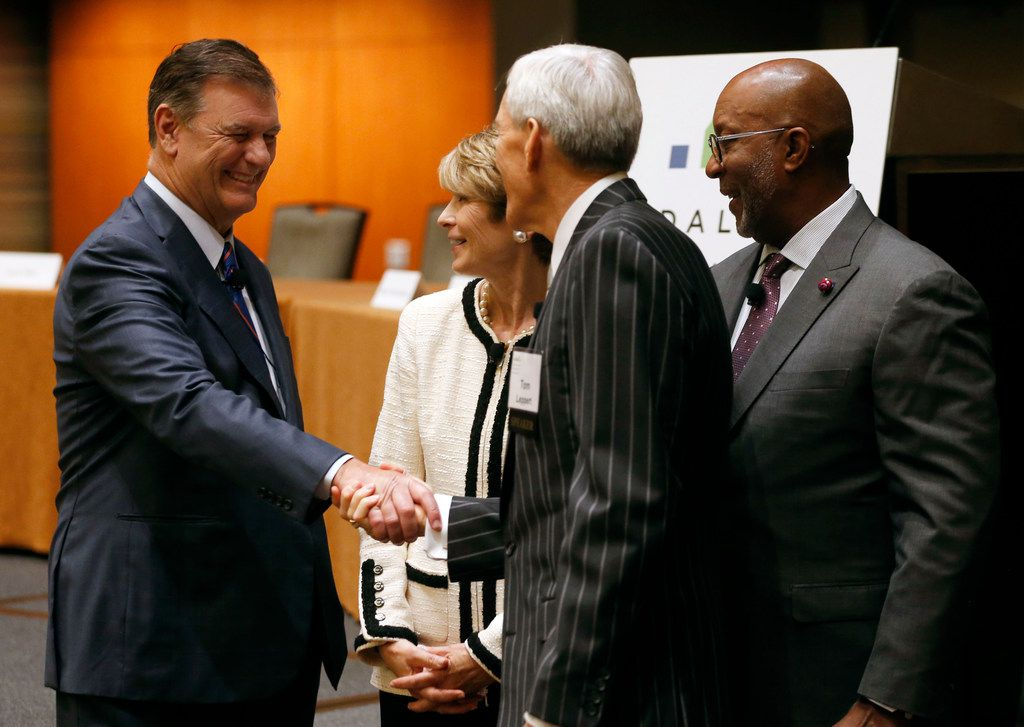 Dallas Mayor Mike Rawlings greets former Dallas Mayor Tom Leppert as former mayors Laura Miller and Ron Kirk look on prior to the start of a panel held by the Dallas Friday Group at the Hyatt Regency in Dallas on Friday, October 12, 2018.