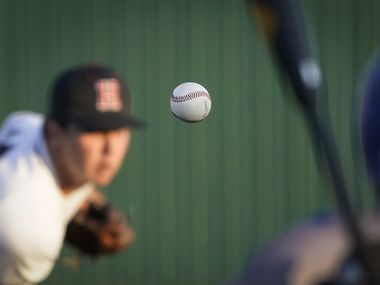 Rockwall-Heath pitcher Josh Hoover delivers to North Mesquite pitcher Kolby Long during a district 10-6A high school baseball game on Thursday, April 1, 2021, in Rockwall.