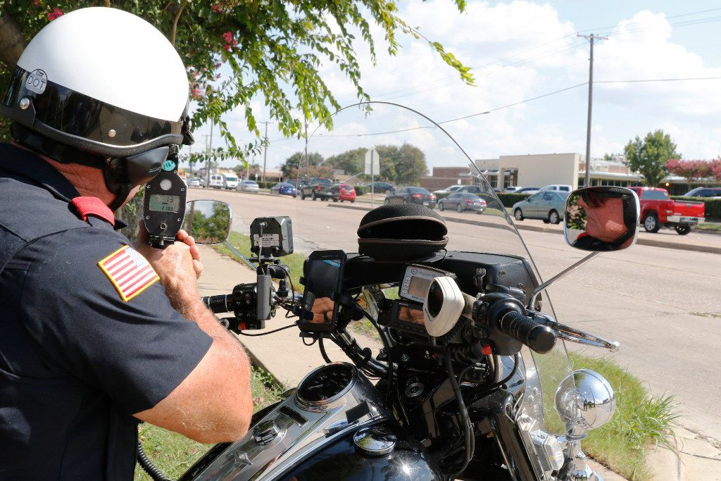 Garland police Officer Lanny Orman looks for motorists speeding, texting, reading or talking on the phone while driving through a school zone.