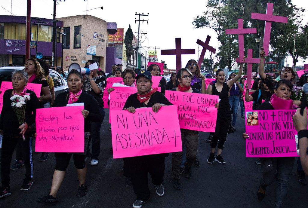 Families and friends march against gender violence on the outskirts of Mexico City in Ecatepec, Mexico, Friday, Aug. 30, 2019.