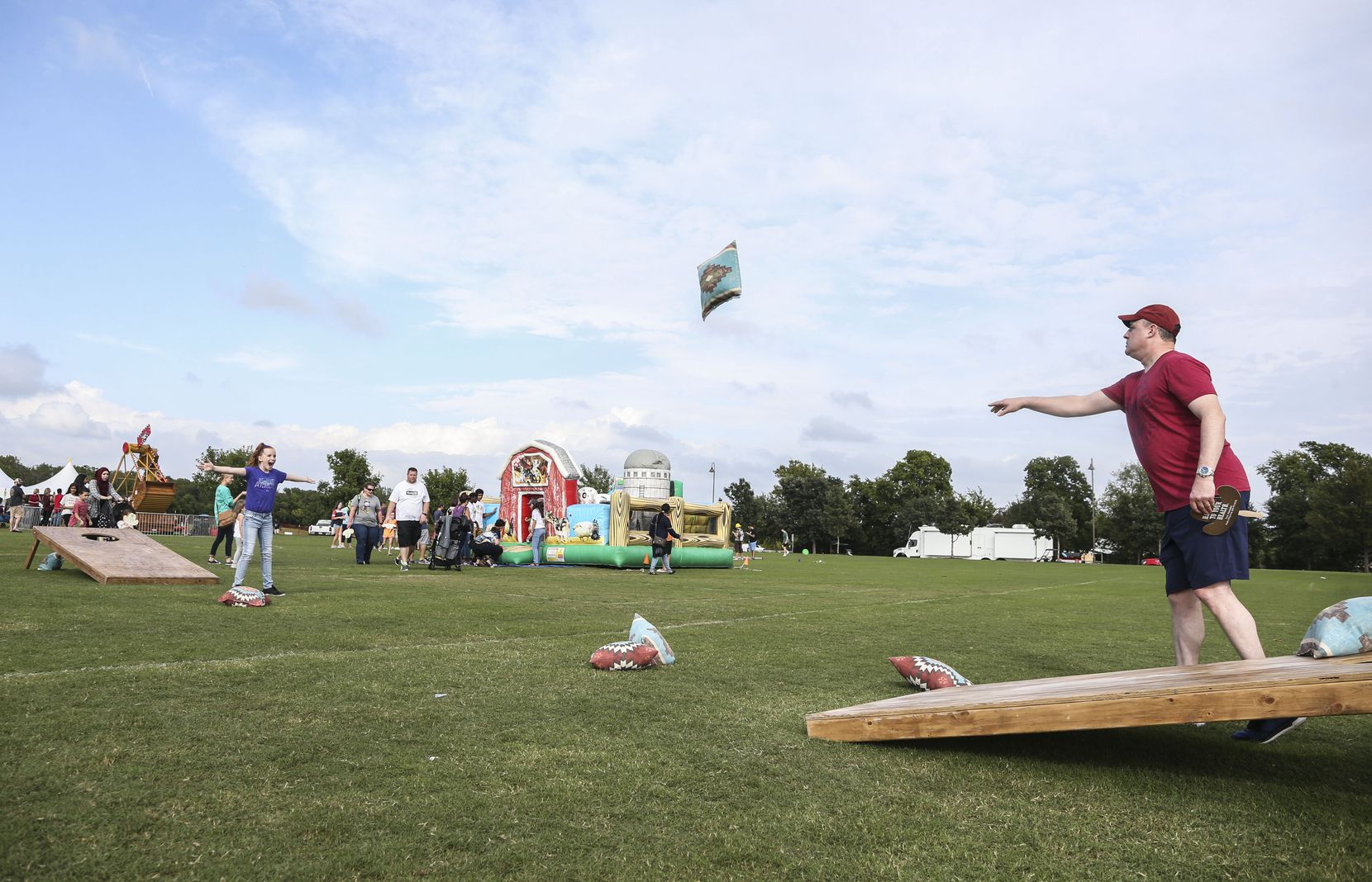 Leyna Anderson spreads her arms out as her father Mike Anderson throws a giant bean bag during Murphy Maize Days in 2018. The 2021 event will be held Sept. 25.