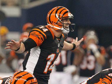 Cincinnati Bengals quarterback Andy Dalton (14) runs the offense against the Dallas Cowboys during their NFL football game in Arlington, Texas, on August 24, 2013.