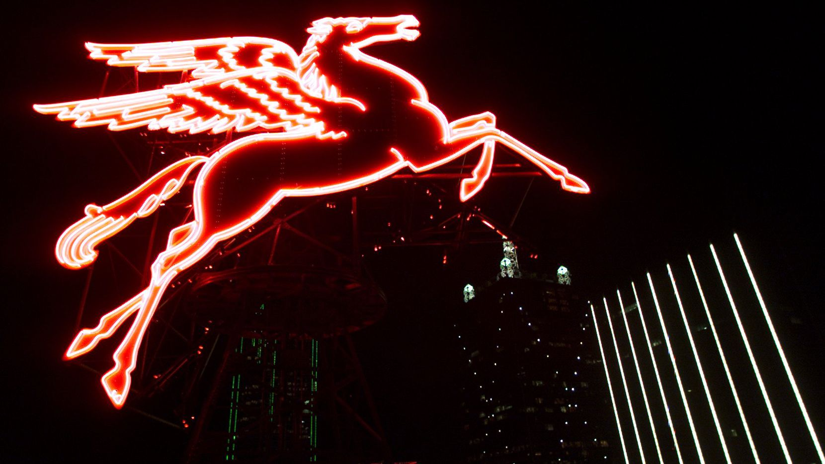 The Giant Pegasus rotates to life as fireworks are shot off in celebration of the year 2000 atop the Magnolia Building in downtown Dallas.