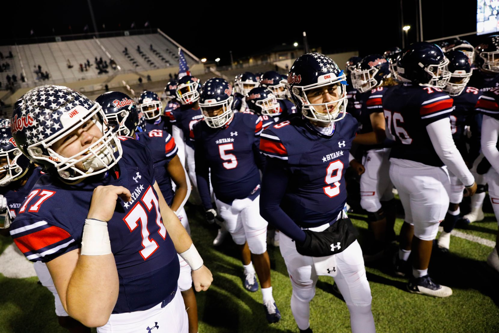 Denton Ryan's players walk to the sidelines before the start of a football game against Frisco Lone Star at the C.H. Collins Complex in Denton on Thursday, Dec. 4, 2020. The game is tied at halftime, 14-14. (Juan Figueroa/ The Dallas Morning News)