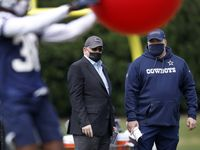 Dallas Cowboys owner Jerry Jones (left) and head coach Mike McCarthy visit on the sideline as they watch rookie cornerback Israel Mukuamu (38) run through minicamp drills at The Star in Frisco, Texas, Friday, May 14, 2021.