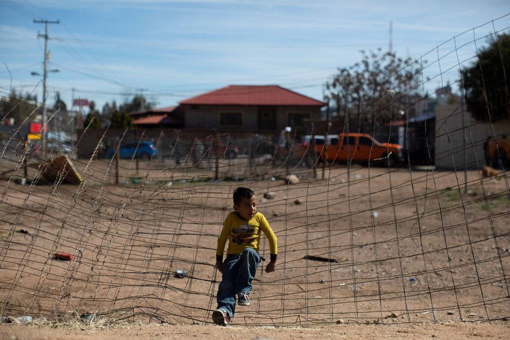 Juan Carlos, 6, a migrant child from Guatemala hoping to cross into the U.S. with his father, sits on a partially collapsed wire fence outside of the Grupo Beta local offices on Feb. 24, 2019, in Nogales, Mexico. The Grupo Beta is a service by Mexico's National Institute of Migration that offers water, food, information and medical aid to immigrants in transit through Mexico.