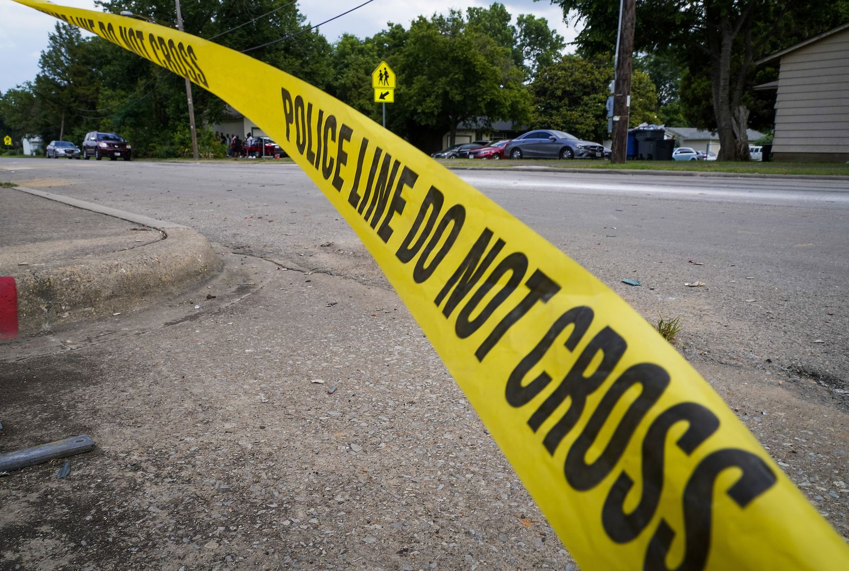 Police tape flutters at the scene scene of a shooting in the 8300 block of Towns Street in Hamilton Park on Monday.