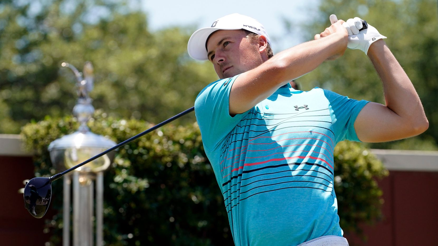 PGA Tour golfer Jordan Spieth tees off to start the third round of the Charles Schwab Challenge at the Colonial Country Club in Fort Worth, Saturday, June 13, 2020.  The Challenge was the first tour event since the COVID-19 pandemic began.