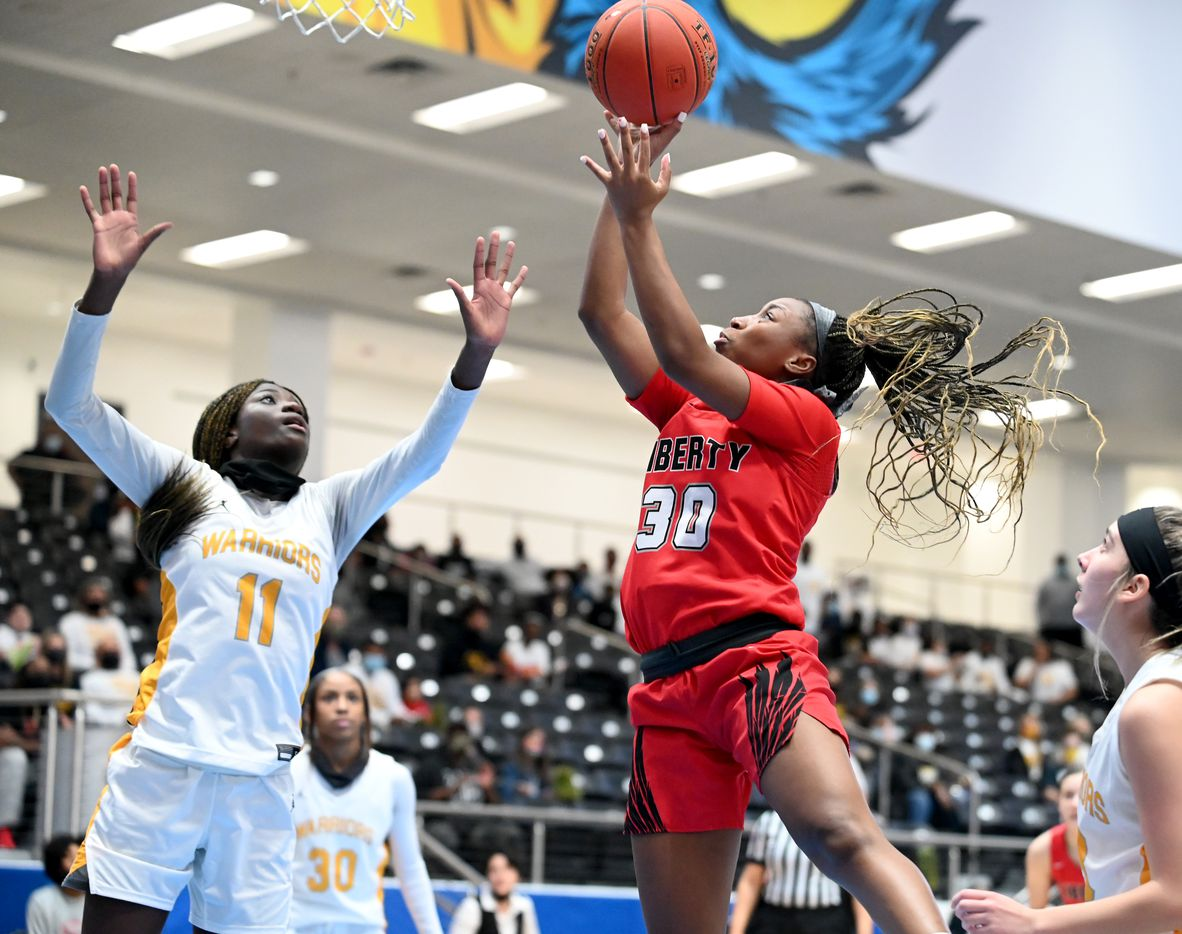 Liberty's Jazzy Owens-Barnett (30) shoots over Liberty's Falyn Lott (11) in the second half of a Class 5A girls high school playoff basketball game between Frisco  Memorial and Frisco Liberty, Wednesday, Feb. 24, 2021, in Frisco, Texas. (Matt Strasen/Special Contributor)