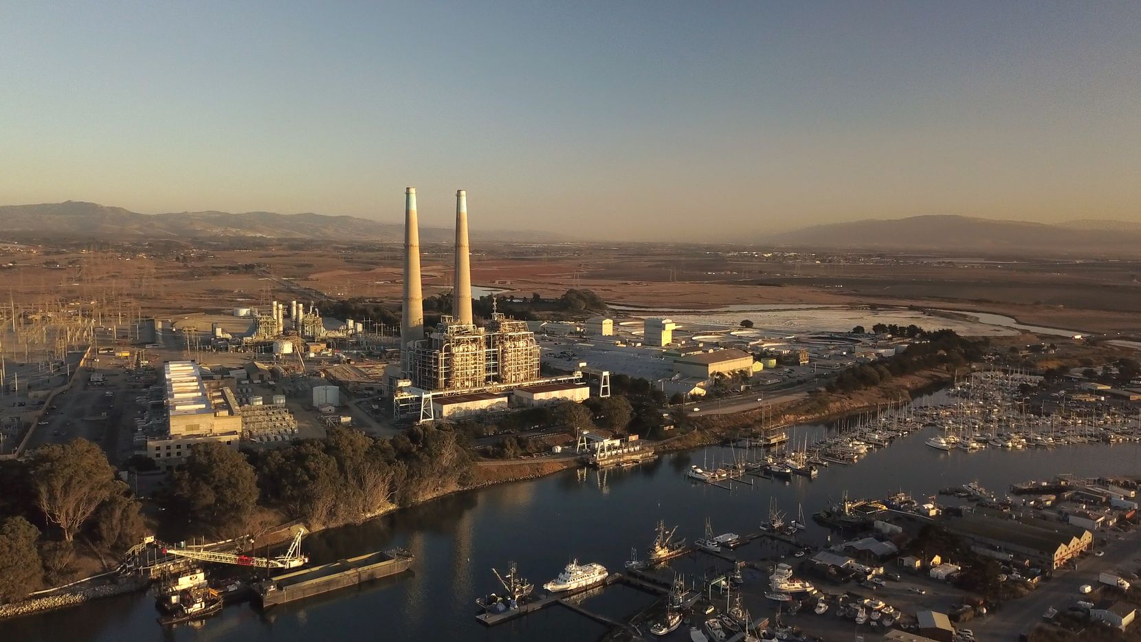 Vistra has plenty of room to add more batteries at its Moss Landing site. It plans to keep the two large smokestacks from its retired power plant because the community appreciates them as a landmark, said CEO Curtis Morgan.