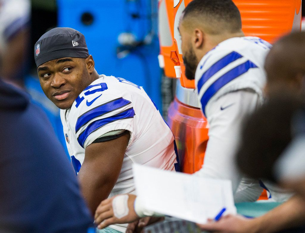 Dallas Cowboys wide receiver Amari Cooper (19) talks with quarterback Dak Prescott (4) on the bench during the fourth quarter of an NFL game between the Dallas Cowboys and the Indianapolis Colts on Sunday, December 16, 2018 at Lucas Oil Stadium in Indianapolis, Indiana. (Ashley Landis/The Dallas Morning News)
