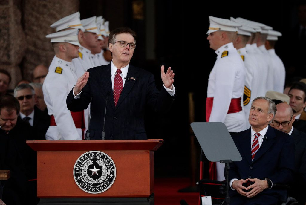 Texas Lt. Gov. Dan Patrick speaks during his inauguration ceremony as Texas Gov. Greg Abbott, right, listens, in Austin, Texas, Tuesday, Jan. 15, 2019.