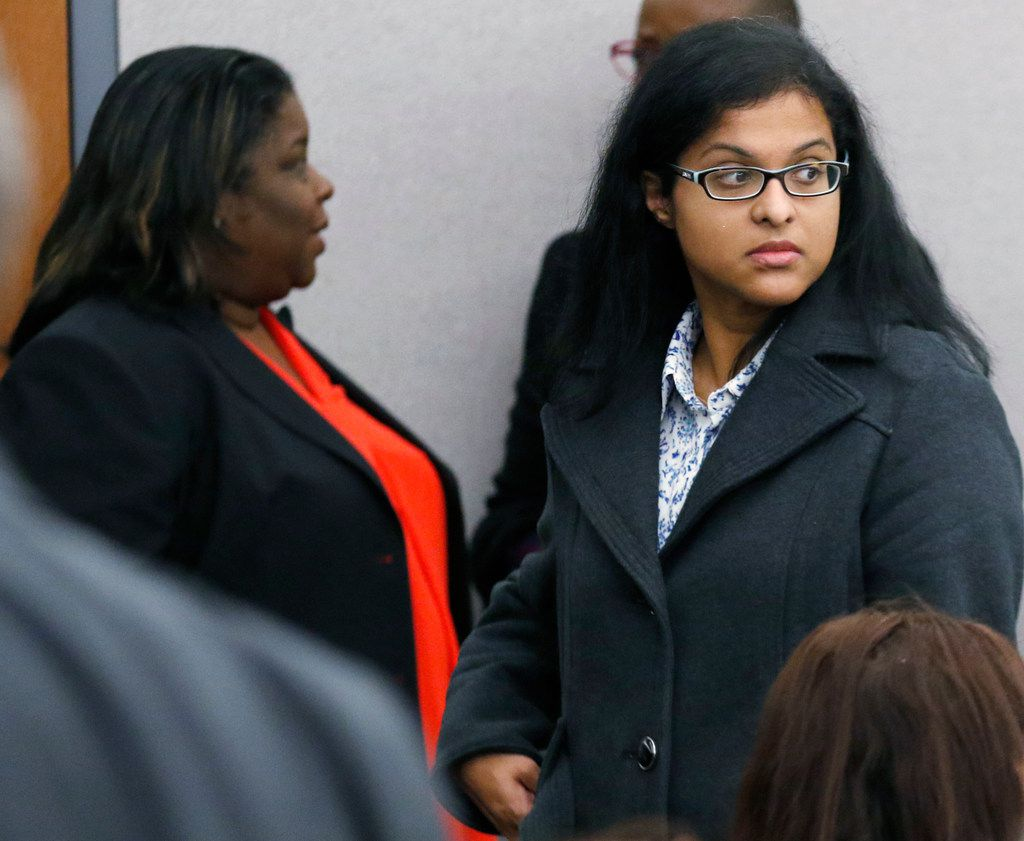 Sini Mathews (right) mother of Sherin Mathews, leaves Judge Cheryl Lee Shannon's courtroom after a hearing to determine custody of Sini and Wesley Mathews' surviving daughter on Monday at the Henry Wade Juvenile Justice Building in Dallas.