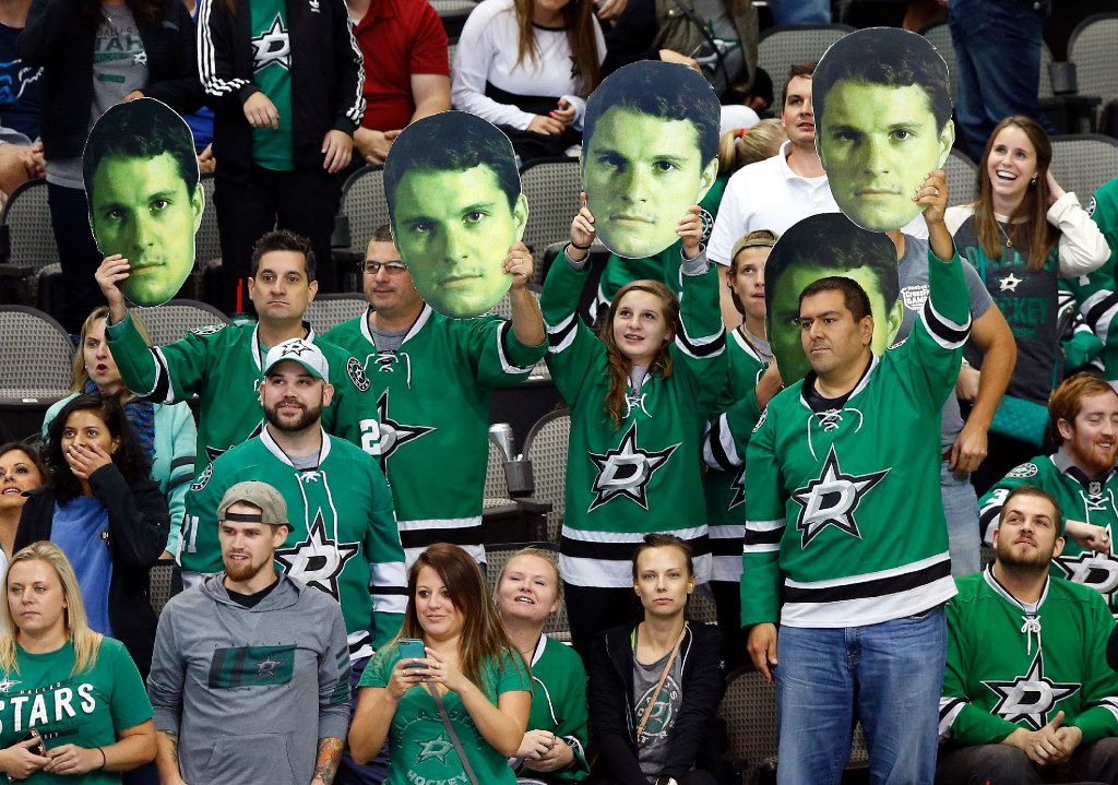 Dallas Stars fans wave cutouts of left wing Antoine Roussel (21) during the third period against Florida Panthers at the American Airlines Center in Dallas, Tuesday, October 4, 2016. (Tom Fox/The Dallas Morning News)