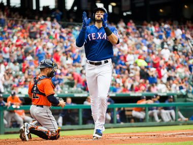 Texas Rangers first baseman Joey Gallo (13) celebrates a home run during the first inning of an MLB game between the Texas Rangers and the Houston Astros on Sunday, April 1, 2018 at Globe Life Stadium in Arlington, Texas.