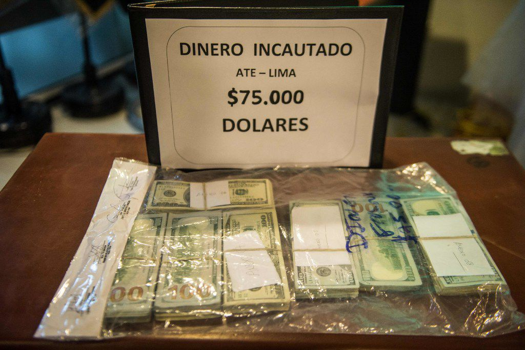 View of money confiscated within the seizure of more than two tons of cocaine hydrochloride during the presentation to the press in Lima on January 12, 2017.  The Peruvian drug squad seized the drug -which was camouflaged in asparagus tins ready to be sent by sea to Amsterdam- and arrested six people, including a Serbian citizan. / AFP PHOTO / Ernesto BENAVIDESERNESTO BENAVIDES/AFP/Getty Images