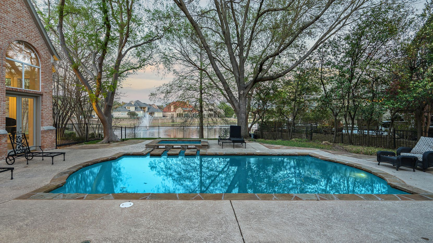 The estate at 4728 Stonehearth Place, which includes a pool and fountain, is located in guard-gated Oakdale, which has a lake and walking trails.