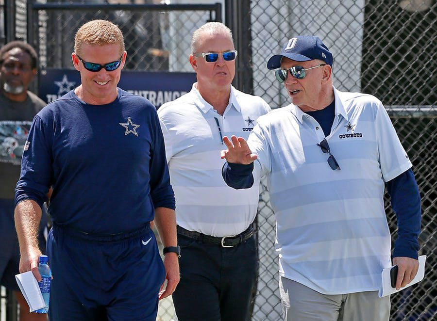 Cowboys owner Jerry Jones, right, talks with head coach Jason Garrett, left, on the way to a press conferences with executive vice president Stephen Jones at the training camp in Oxnard, Cali., Wednesday, July 25, 2018. (Jae S. Lee/The Dallas Morning News)