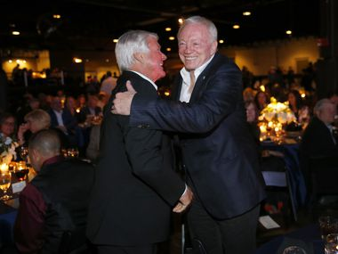 Dallas Cowboys owner Jerry Jones (right) and his former Super Bowl winning coach Jimmy Johnson shake hands and hug following the 25th Anniversary of the Dallas Cowboys Super Bowl XXVII at Gilley's in Dallas, Saturday, February 25, 2017. The event was hosted by Troy Aikman and United Way of Metropolitan of Dallas in which he is the new fundraiser. The evening featured appearances by Cowboys legends, a conversation with head coach Jimmy Johnson and other members of the 1992 coaching staff, and a special celebration honoring Jerry Jones for his election to the Pro Football Hall of Fame. (Tom Fox/The Dallas Morning News)