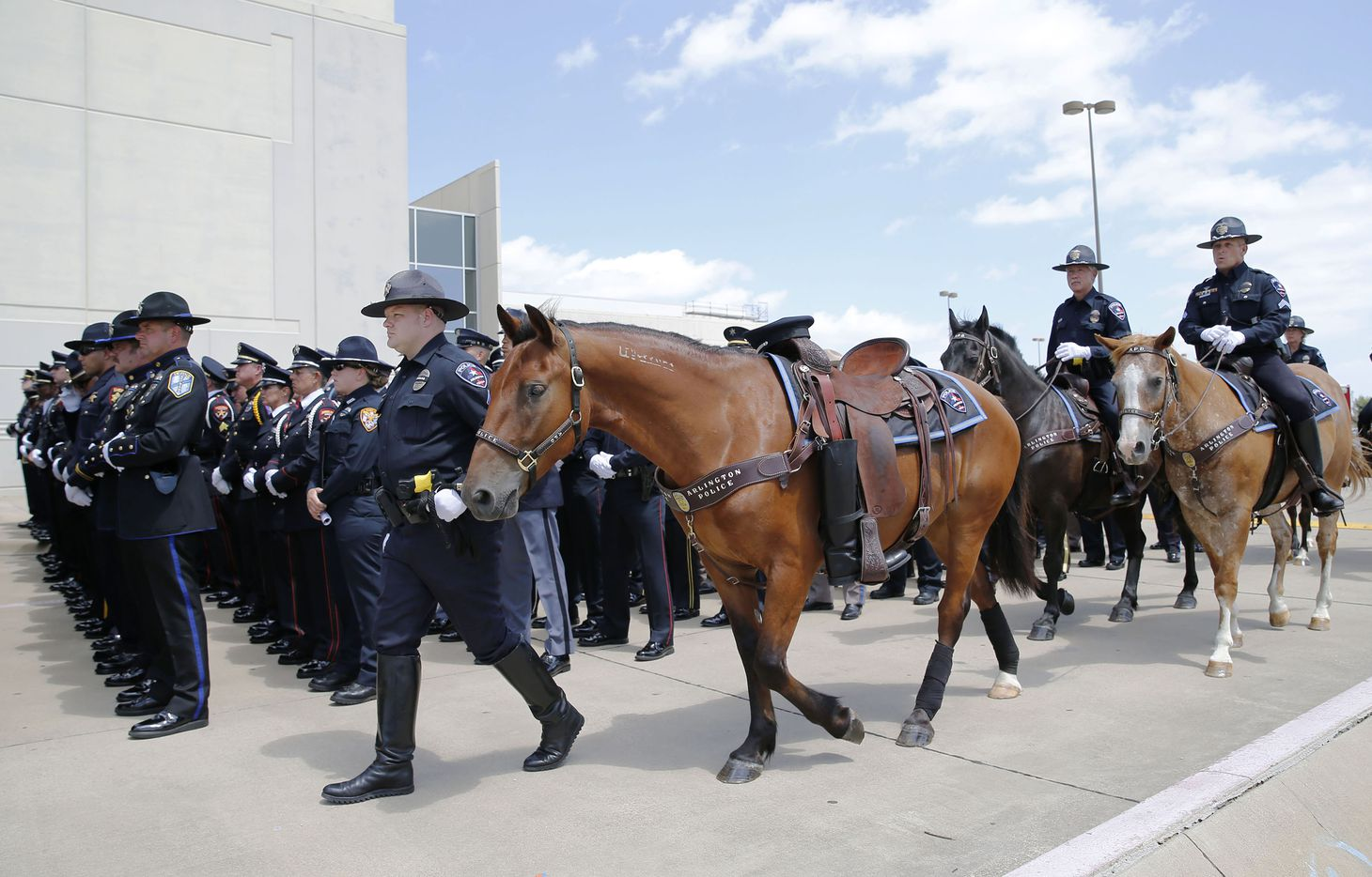A riderless horse was guided down the street during the memorial service for DART Officer Brent Thompson on Wednesday.
