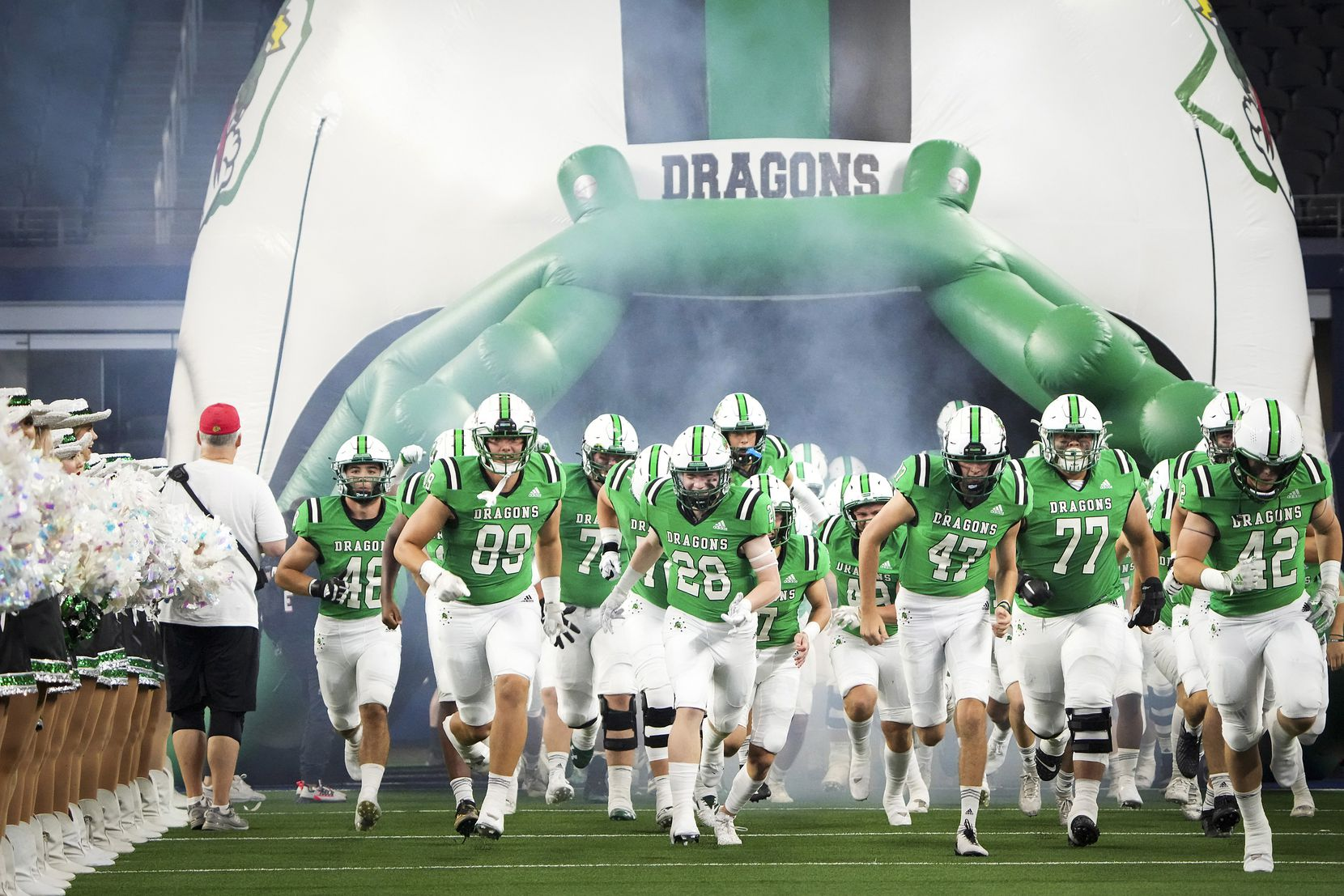 Southlake Carroll players take the field to face Highland Park in a high school football game at AT&T Stadium on Thursday, Aug. 26, 2021, in Arlington.