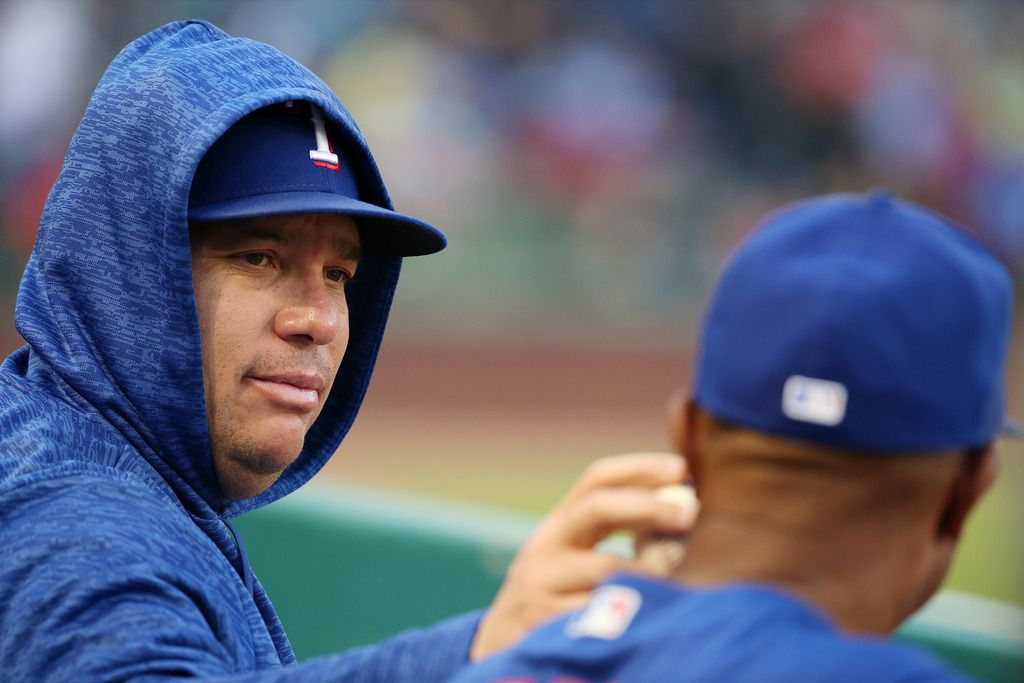 Texas Rangers starting pitcher Bartolo Colon (40) touches a ball to the neck of Texas Rangers third base coach Tony Beasley (27) in the dugout during a Major League Baseball game between the Detroit Tigers and the Texas Rangers at Globe Life Park in Arlington, Texas Tuesday May 8, 2018. (Andy Jacobsohn/The Dallas Morning News)