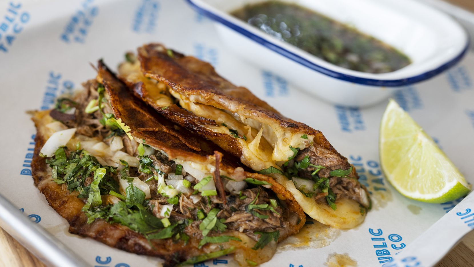 One of Public Taco's more popular items is its crispy birria tacos: grilled crispy tacos with barbacoa, served with a bowl of consommé. The restaurant has closed twice since early 2020. In July 2021, it opened for a third time at Preston-Royal in Dallas.