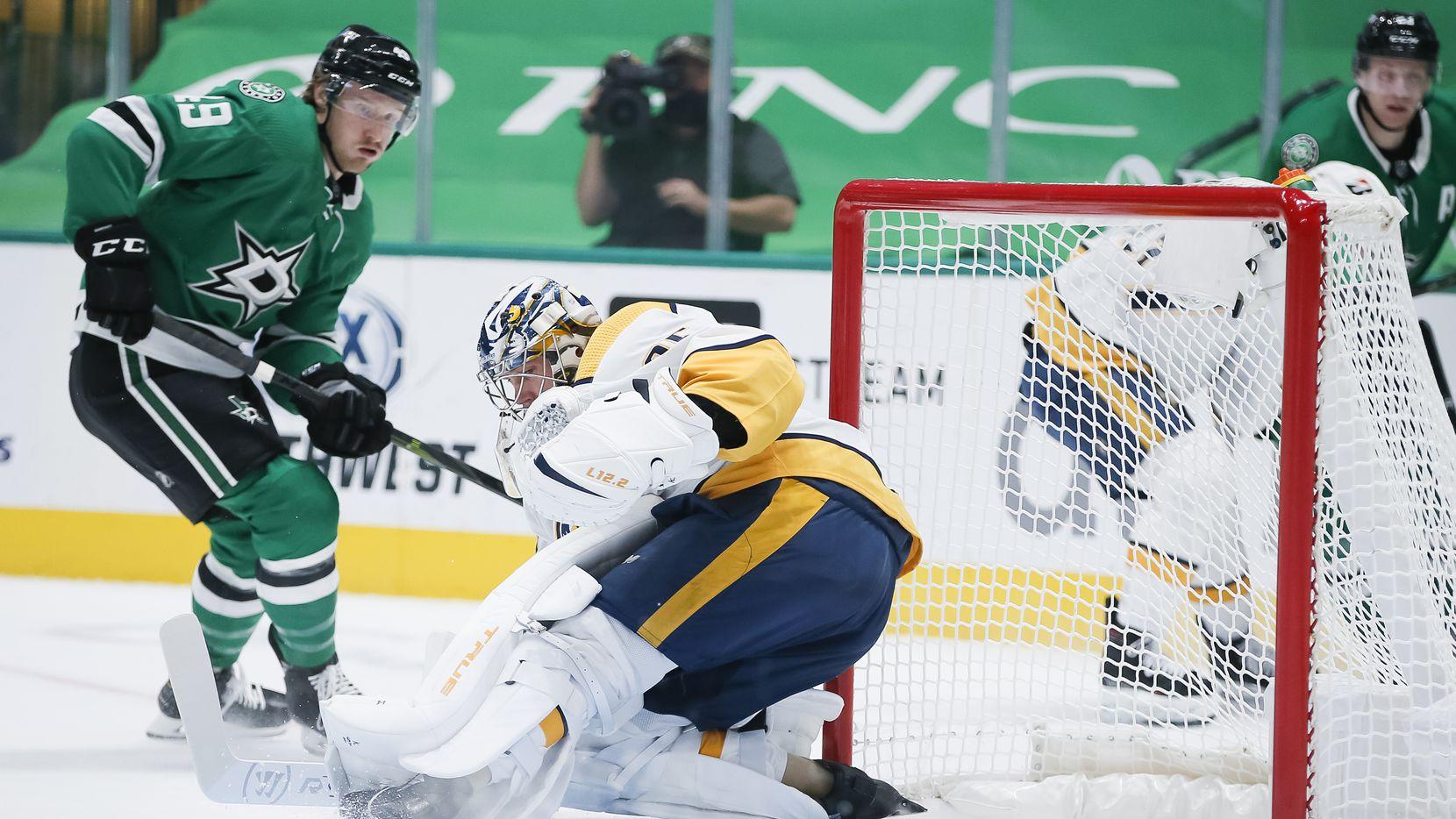 Dallas Stars forward Rhett Gardner (49) scores a goal against Nashville Predators goaltender Pekka Rinne (35) during the first period of an NHL hockey game in Dallas Sunday, March 21, 2021.