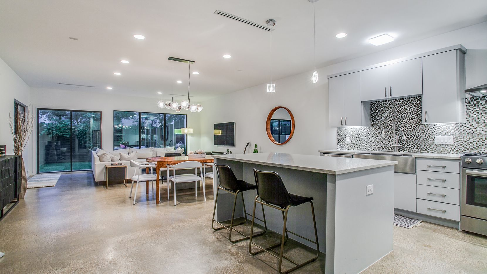 The modern home at 4214 Munger Ave. offers mood-lifting, light-filled rooms.