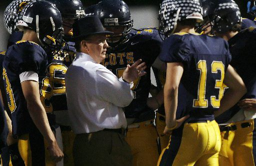 Highland Park head coach Randy Allen talks with quarterback Luke Woodley (13) and the offense before the start of their District 10-4A football game between Royse City High School and Highland Park High School at Highlander Stadium in Dallas, Texas, Friday, October 24, 2008.