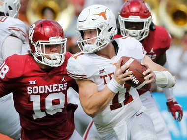 Texas Longhorns quarterback Sam Ehlinger (11) rolls out away from pressure from Oklahoma Sooners linebacker Curtis Bolton (18) during the University of Texas Longhorns vs. the Oklahoma Sooners NCAA football game at the Cotton Bowl in Dallas on Saturday, October 6, 2018.