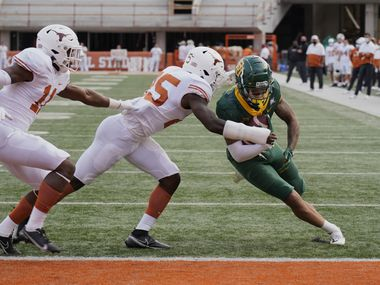 Baylor's Gavin Holmes (6) runs past Texas' B.J. Foster (25) and Anthony Cook (11) for a touchdown during the second half of an NCAA college football game in Austin, Texas, Saturday, Oct. 24, 2020.