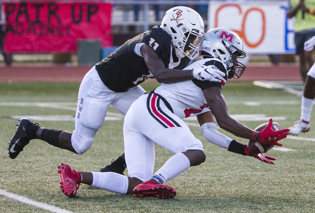 Flower Mound Marcus wide receiver J. Michael Sturdivant (7) catches a pass while being tackled by Arlington Bowie defensive back Jalen Curvin (11) during the first quarter of a high school football game between Flower Mound Marcus and Arlington Bowie on Thursday, August 29, 2019 at Wilemon Field in Arlington. (Ashley Landis/The Dallas Morning News)