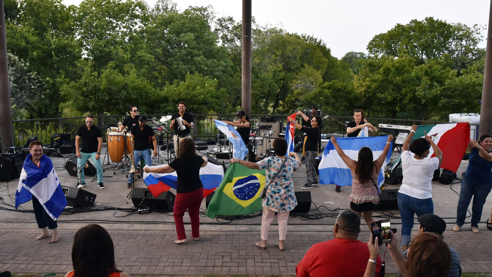 Salsa fans dance with a collection Latin flags during a performance by Havana NRG during the 2017 Latino Heritage Festival in DeSoto.