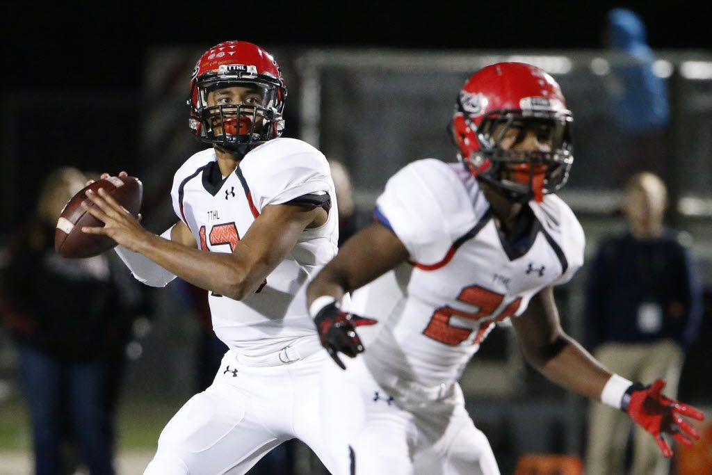 Cedar Hill quarterback Avery Davis (12) looks to throw the ball in the first half during a 6A Division II Region 1 bi-district high school football playoff game between Cedar Hill and Southlake Carroll at Dragon Stadium in Southlake, Texas Friday November 13, 2015. (Andy Jacobsohn/The Dallas Morning News)