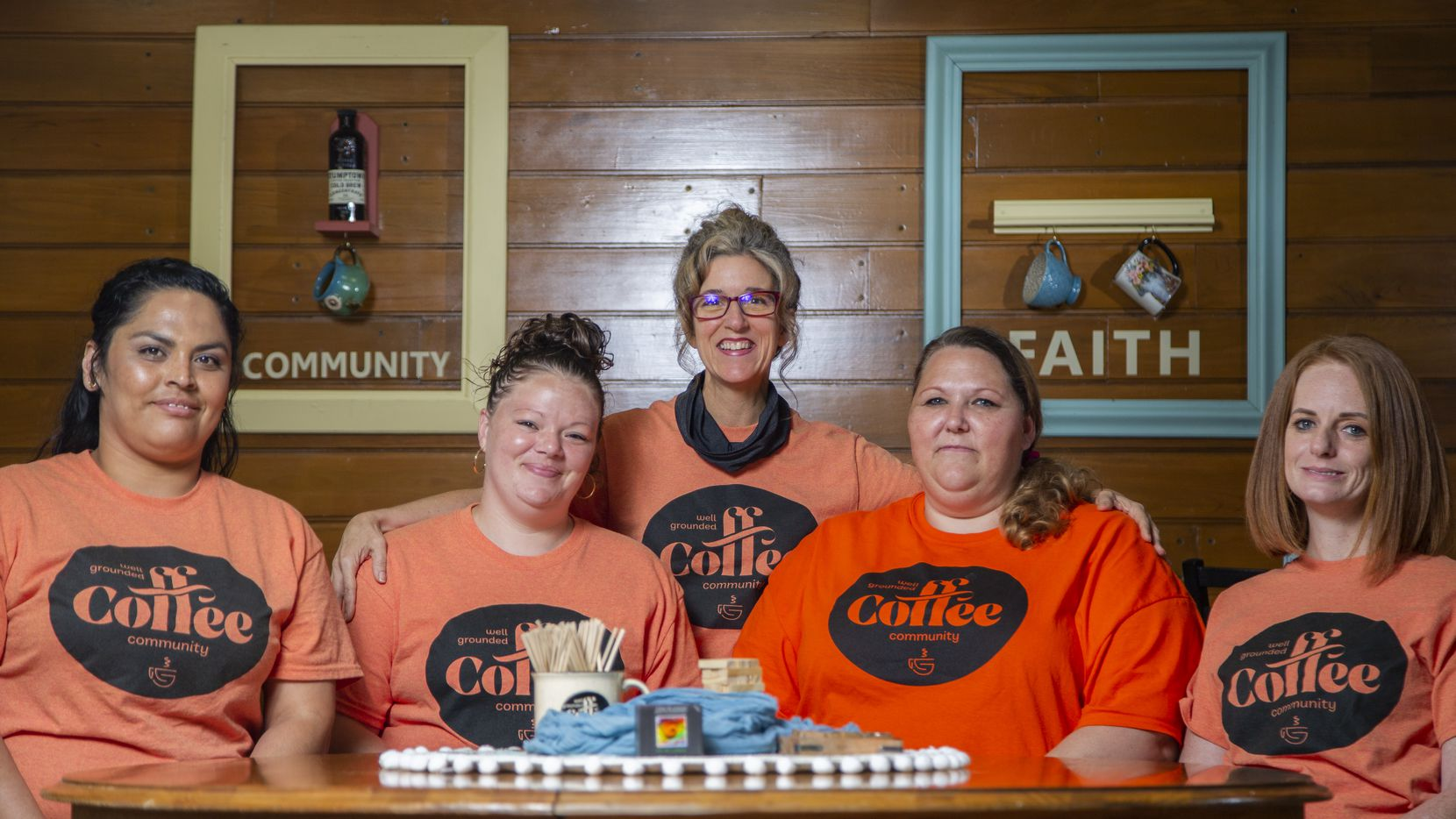 Well Grounded Coffee Community owner Natalie Huscheck (center) says her life has been blessed by her interactions with her employees Maricela Espinosa (from left), Hannah Dorsey, Angela Walterscheid and Natasha Weir.