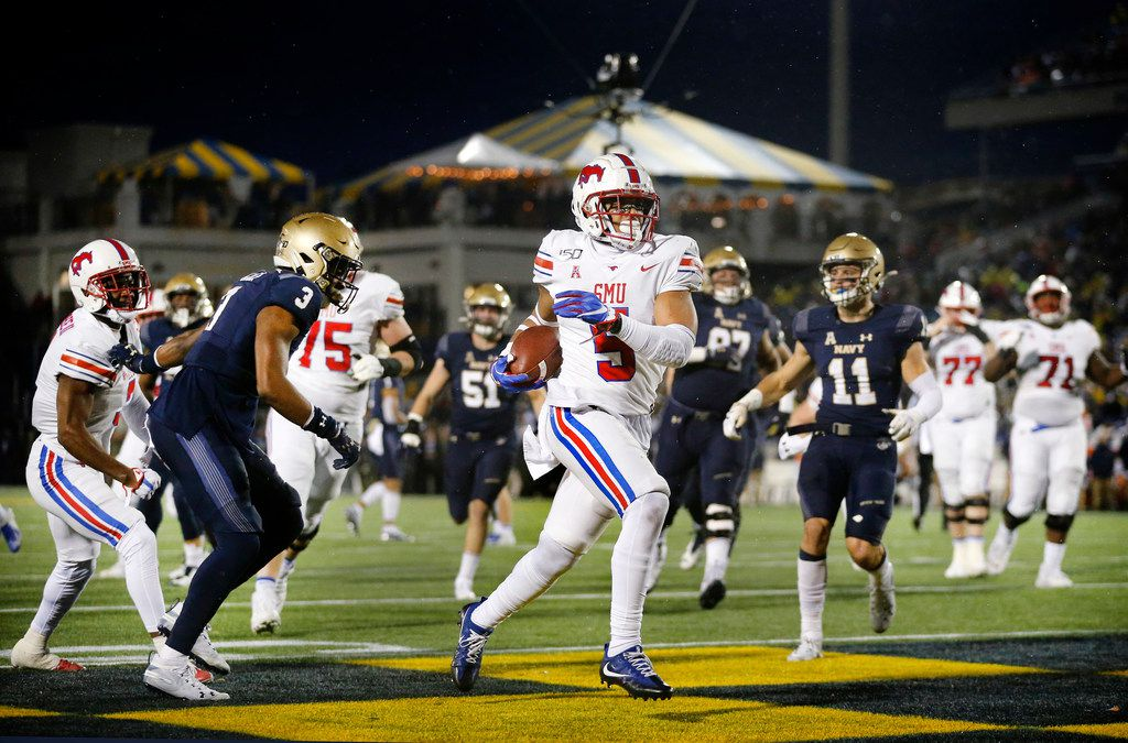 Southern Methodist Mustangs running back Xavier Jones (5) runs in a second quarter touchdown against the Navy Midshipmen defense at Navy-Marine Corps Memorial Stadium in Annapolis, Maryland, Saturday, November 23, 2019. (Tom Fox/The Dallas Morning News)