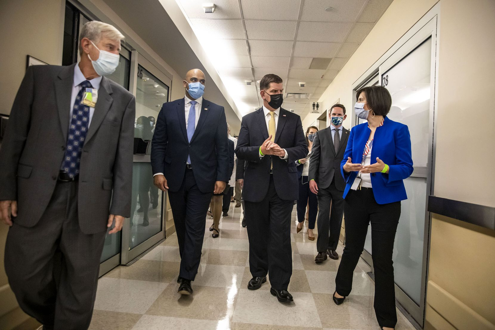 U.S. Labor Secretary Martin Walsh (center) toured the Garland Veterans Affairs Medical Center with Rep. Colin Allred (second from left) on Thursday.