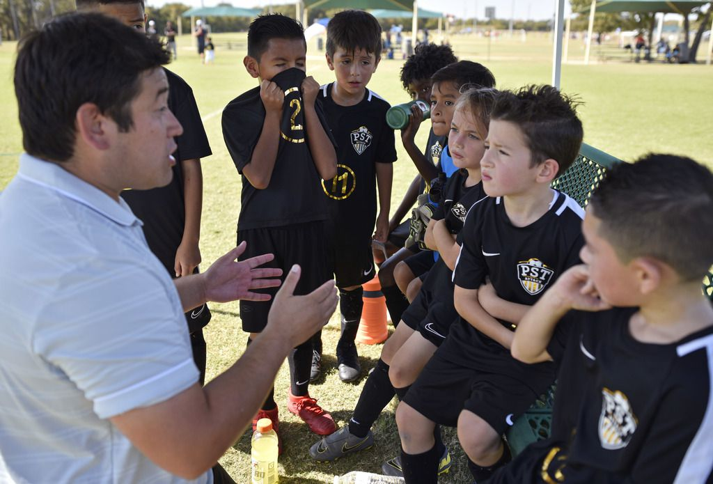 Head coach Lu Salazar of PST Attack 2012 speaks with his team during half time of a game versus Texas Chaos 2011 at Meadowmere Park in Grapevine, Oct. 20, 2019. Ben Torres/Special Contributor
