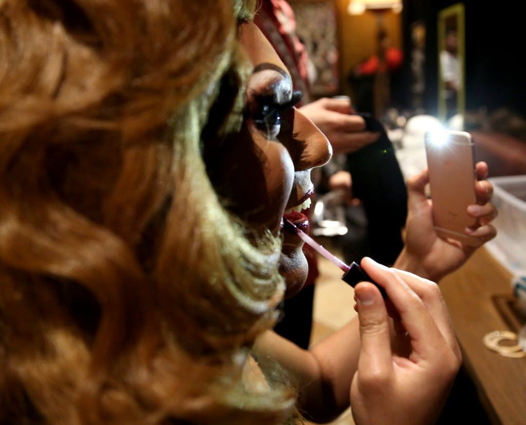 Contestant Amerie Parker puts on lip gloss before the Miss Gay Texas America preliminary round at Station 4 in Dallas on Wednesday, July 20, 2016 (Rose Baca/The Dallas Morning News)