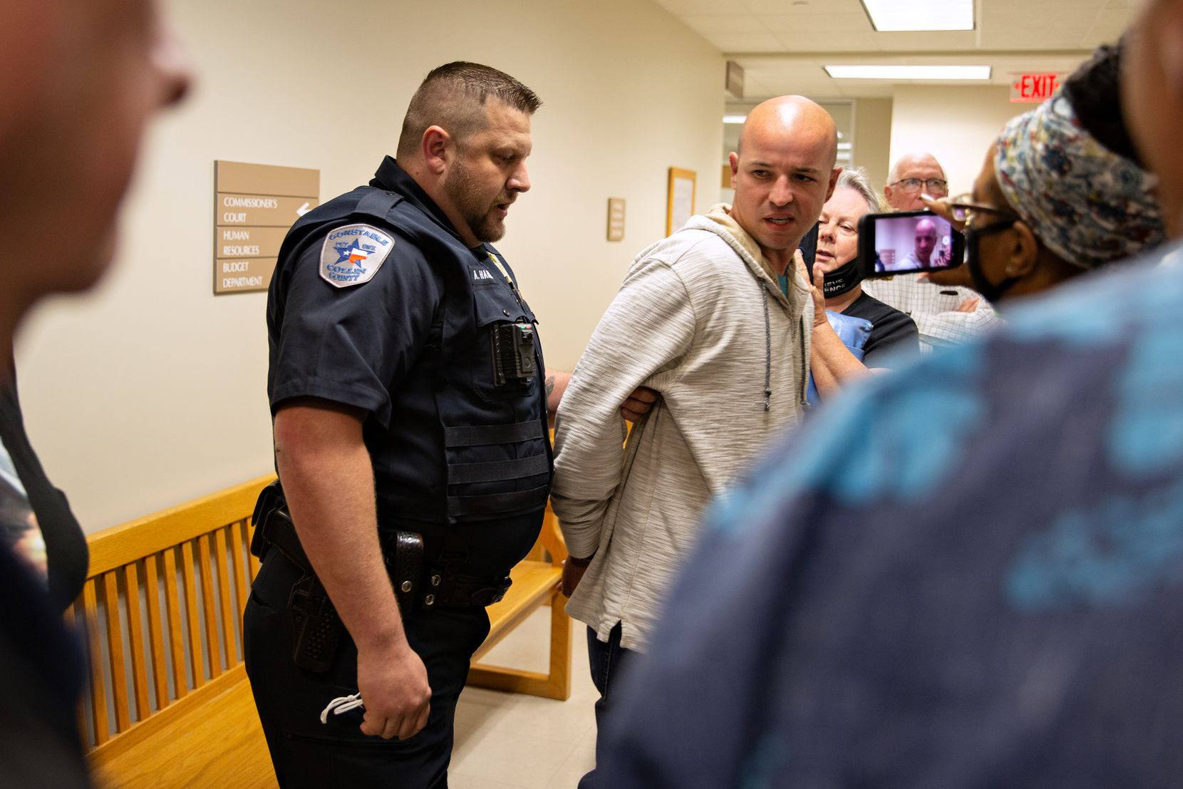 Joshua Murray is arrested by police after Judge Chris Hill ruled Murray in contempt of court at the Collin County Commissioners Court meeting at the Collin County Administration Building in McKinney, TX on Monday, May 24, 2021. (Shelby Tauber/Special Contributor)
