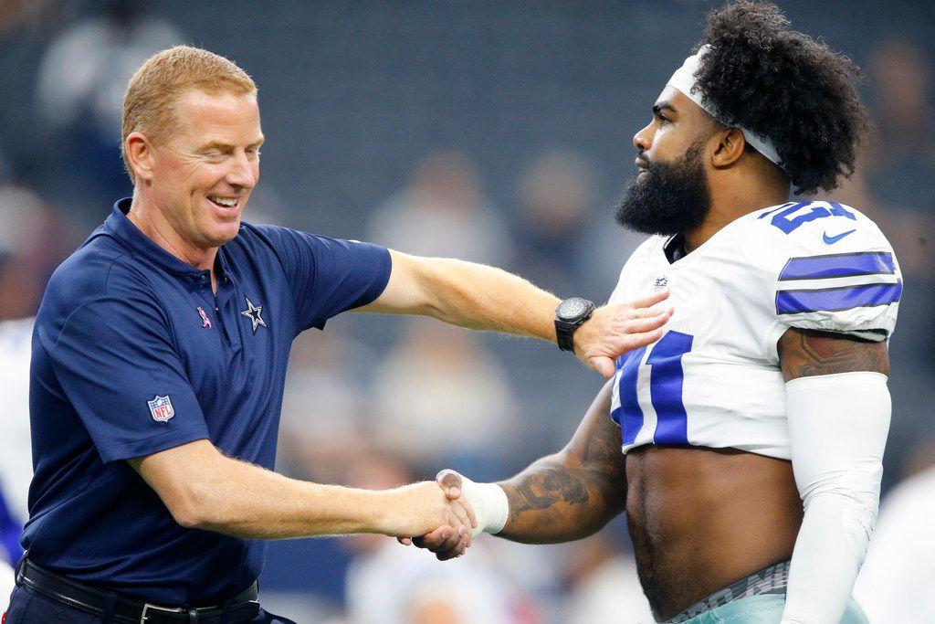 Cowboys head coach Jason Garrett greets running back Ezekiel Elliott (21) during pregame warmups at AT&T Stadium in Arlington on Sunday, Oct. 14, 2018. The Cowboys were facing the Jacksonville Jaguars.