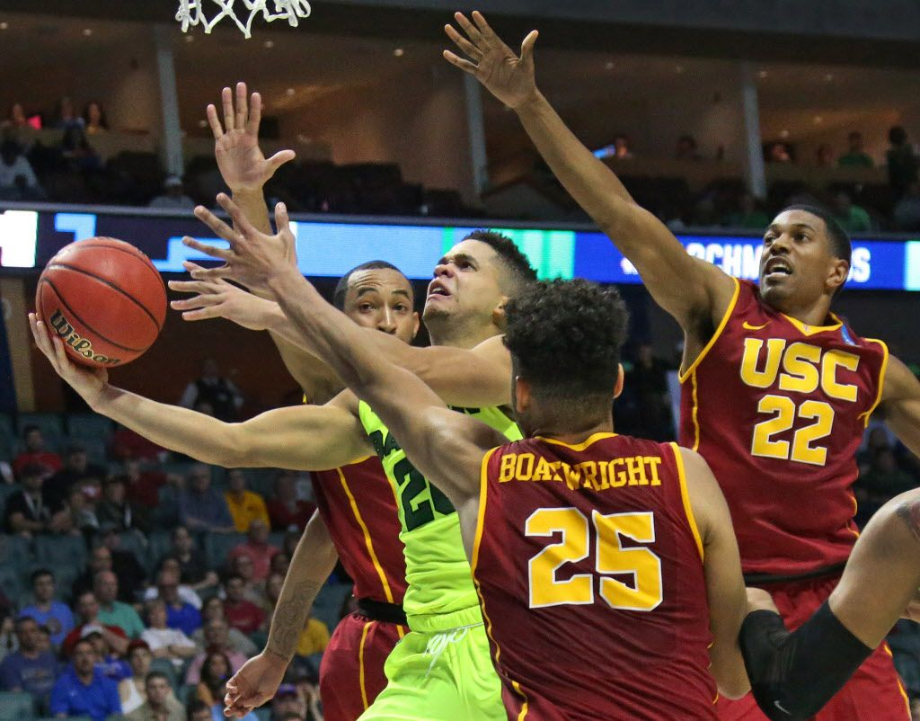 Baylor Bears guard Manu Lecomte (20) cuts through the Trojan defense to the basket in the second half during the USC Trojans vs. the Baylor Bears NCAA men's basketball game at the BOK Center in Tulsa, Oklahoma on Sunday, March 19, 2017. (Louis DeLuca/The Dallas Morning News)